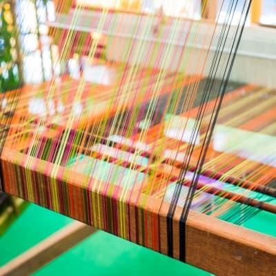 Visite d'une fabrique de tapis en soie